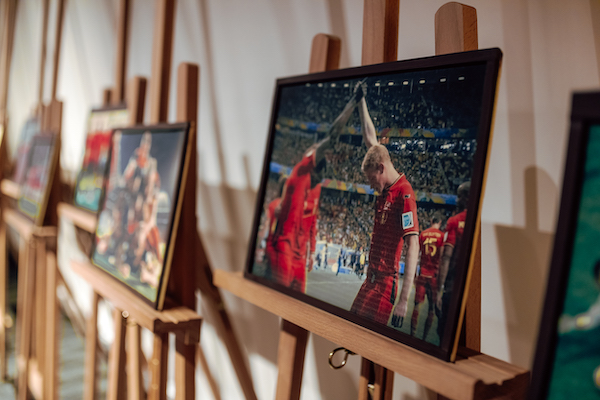 Red Devil's images on easels
